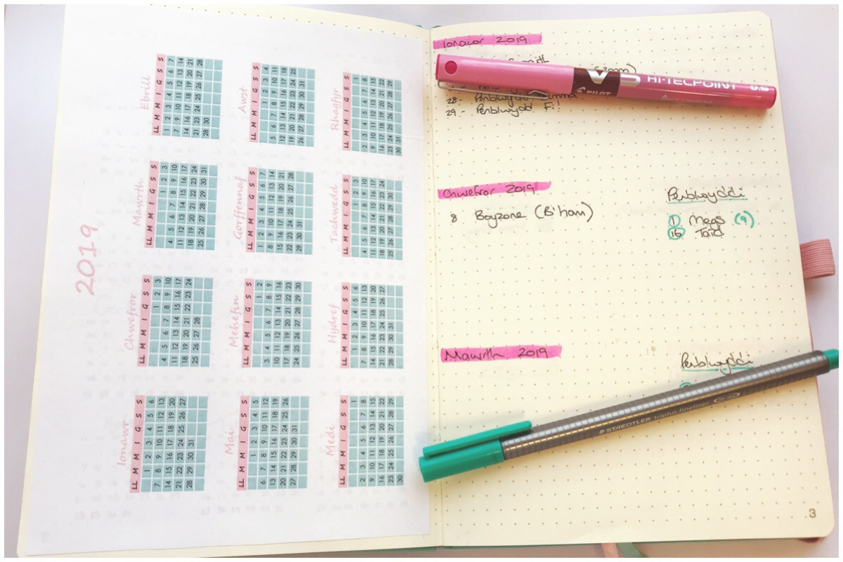 A photo of my bullet journal open on the calendar page which you can download.