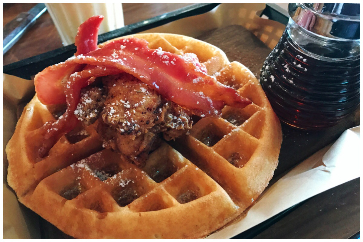 The Chicken Fried Waffle at HIckory's Smokehouse. Buttermilk fried chicken, served on a waffle with bacon and maple syrup - the most amazing thing ever!