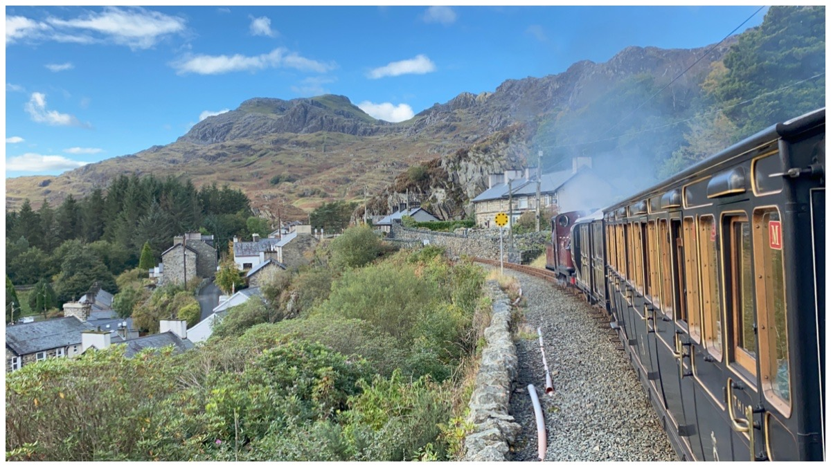 Ffestiniog & Welsh Highland Railways' Prince pulling our train through Tanygrisiau with Moelwyns in the background