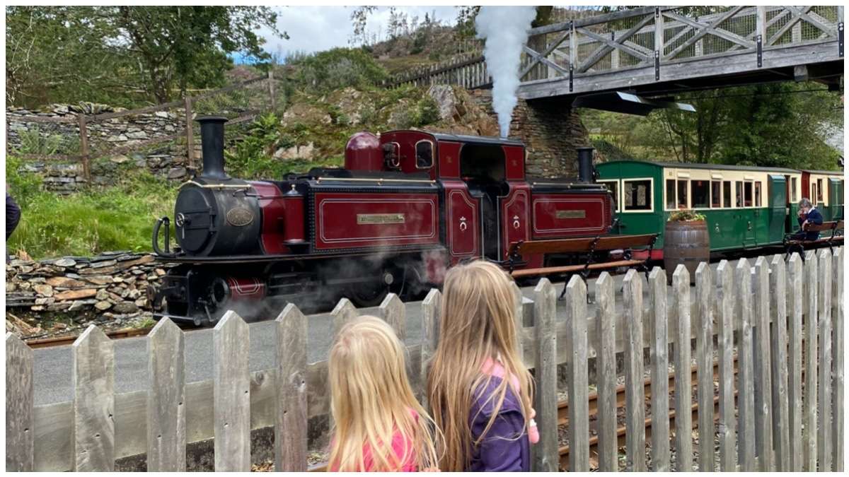 The girls watching Merddin Emrys at Tan Y Bwlch Station on the Ffestiniog Railway