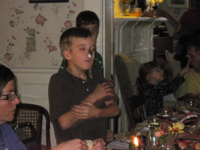 Thanksgiving Dinner entertainment by John.  The other kids joined in of course!