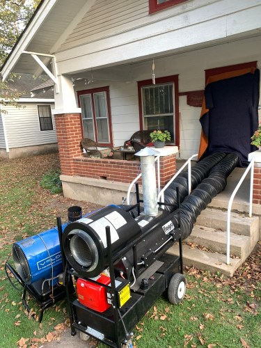 Heat treatment for bed bugs. Image shows 2 of our bed bug heaters pushing hot fume free air into our clients home just outside of Tulsa OK.