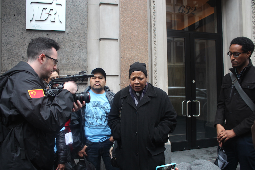 Rev. Valerie Holly speaking at tenant March against Croman last month (Photo: Luisa Rollenhagen)