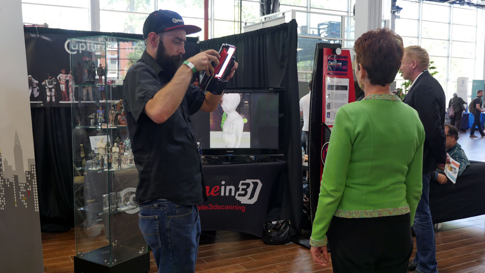 A woman starts the 3D selfie process with the capturemein3D scanner staff. (Photo: Karissa Gall)