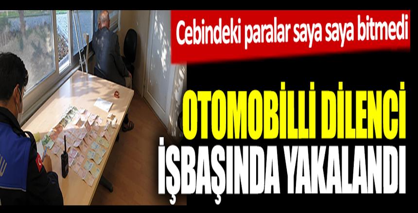 Zeytinburnu'nda otomobilli dilenci işbaşında yakalandı. Cebinden çıkan paralar saya saya bitmedi