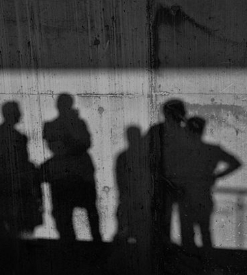 Shadows of people on a wall