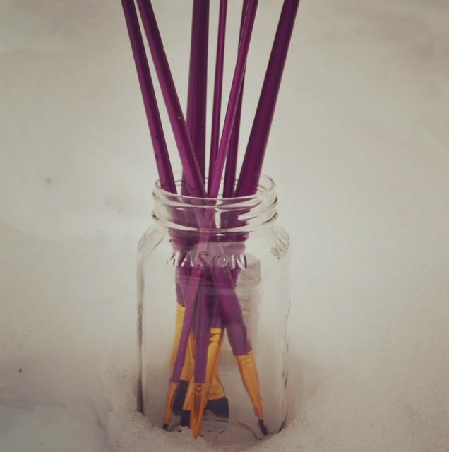 paintbrushes in mason jar