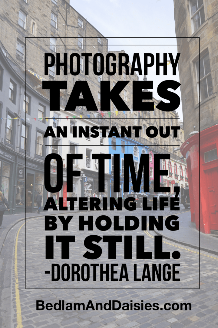 Photography takes an instant out of time, altering life by holding it still. - Dorothea Lange. Photo quote placed over photo of Victoria Street in Edinburgh Scotland