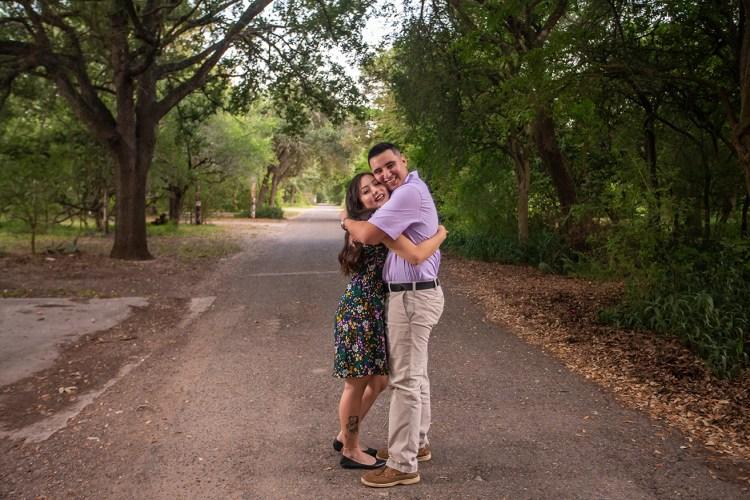 engaged couple hugging estero llano grande