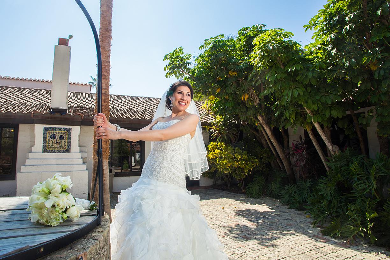 Bride posing for photos outside of Quinta Mazatlan in McAllen, Texas.