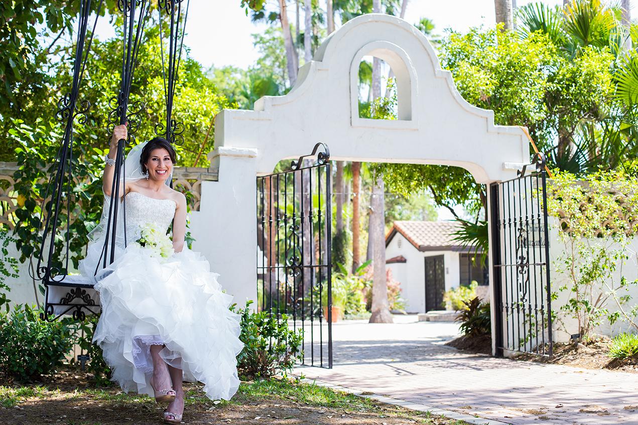 Bride sitting on swing at Quinta Mazatlan in McAllen, Texas.