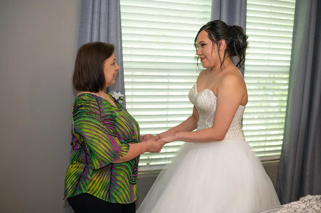 mother and bride having a moment before the wedding