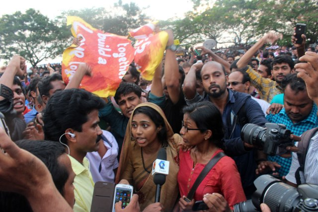 Kiss of love protesters talking to media