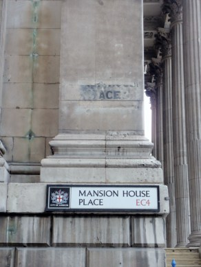 Mansion House Place road sign with ghost sign above