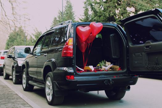 Heart shaped balloons in an SUV trunk