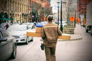 Delivery man carrying packages to car