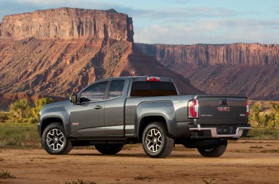 http---image.motortrend.com-f-roadtests-trucks-1401_2015_gmc_canyon_first_look-60391805-2015-GMC-Canyon-rear-three-quarters