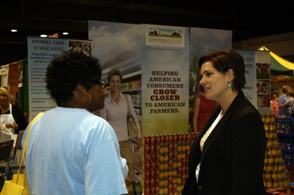 Jennifer talking with a Lexington, Ky. Incredible Food Show visitor as part of the CommonGround program.