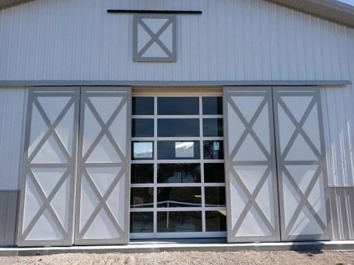 Acrylic full view overhead pole barn door and sliding pole barn doors by Beehive Buildings