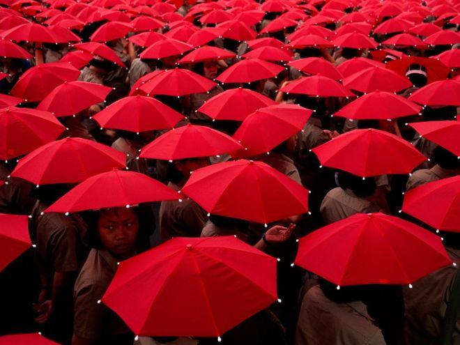 Schoolchildren With Umbrellas by Jodi Cobb