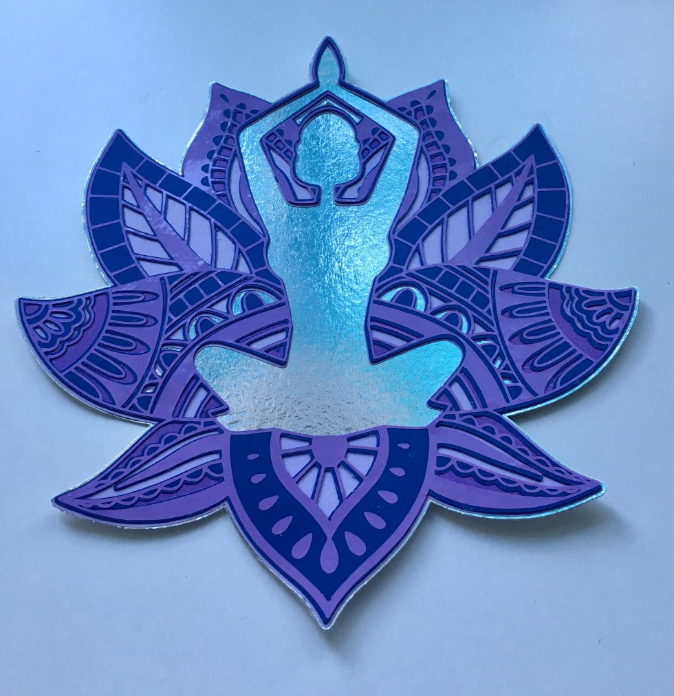purple, blue and silver image of a woman sitting in a mandala lotus flower