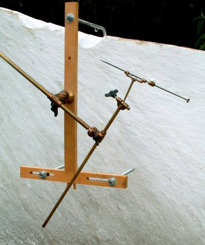 pointing machine with wooden cross and brass needle