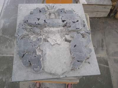 coat of arms in bluestone: 2-precarving the helm
