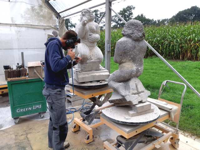 Jelle Steendam busy carving a copy of the flying buttress statuette of Gluttony