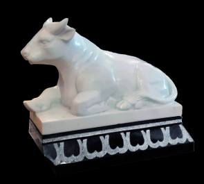 reclining bull in white marble