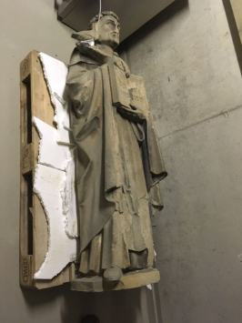 the original statue of Thomas Aquinas, damaged.