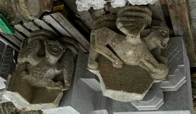 Two winged cubistic creatures: old tufa stone corbels from 1954 by John Grosman from the Eusebius Tower in Arnhem