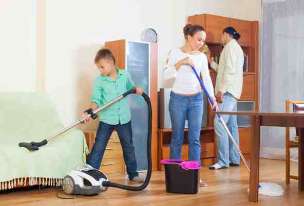 family of three doing housework together