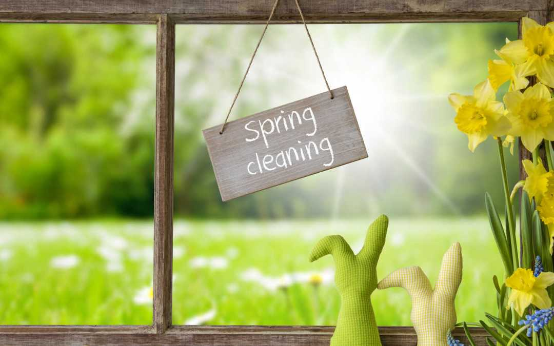 Sign With English Text Spring Cleaning. Window Frame With View To Beautiful Sunny Green Meadow. Easter Bunny