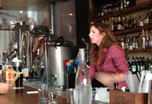 Manager/Founder Elizabeth Wells chats with happy patrons at Southpaw