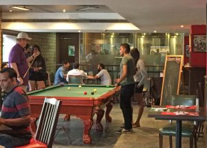Shooting Pool at the Beire Club