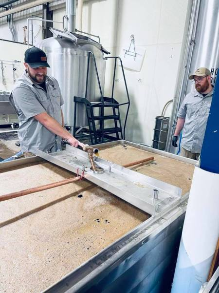 Warrior Brewing Company founders Matt Caple (left) and Benjamin Gipson mashing in at their new Duluth brewery • Photo via Warrior Brewing Company