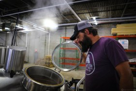 Co-founder and head brewer Travis Herman hard at work