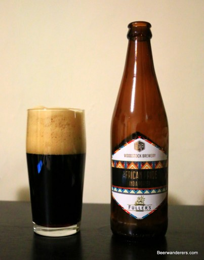 black beer in glass with bottle
