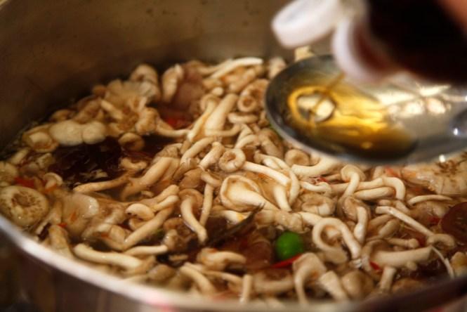 Adding fish sauce for saltiness