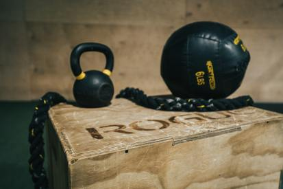 kettlebell and slam ball home gym equipment sitting on a box