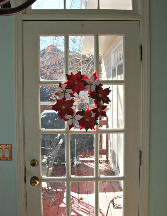 poinsetta wreath on door