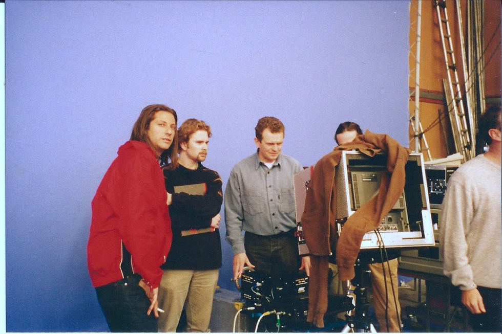 From left, director Jonathan Glazer, VFX Designer/Supervisor Dan Glass and other crew members check the video assist. Image courtesy Paddy Eason.