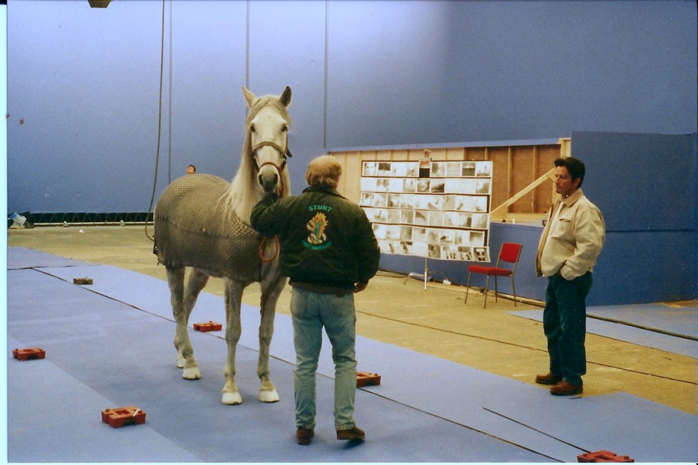On the set with the horse trainer and DOP. The storyboards are in the background. Image courtesy Paddy Eason.