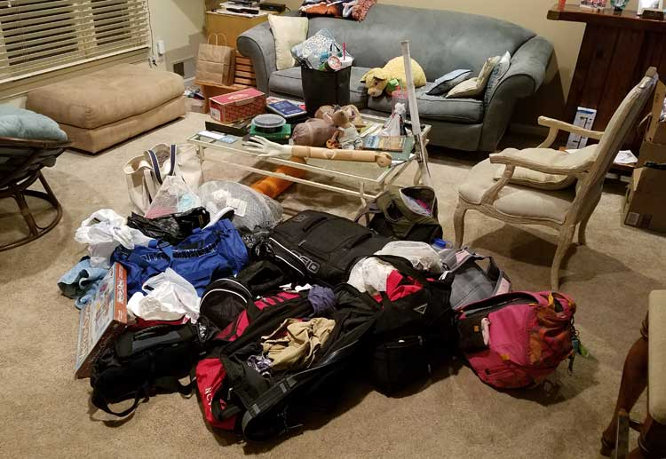 big trip 13 luggage has been dumped in the living room