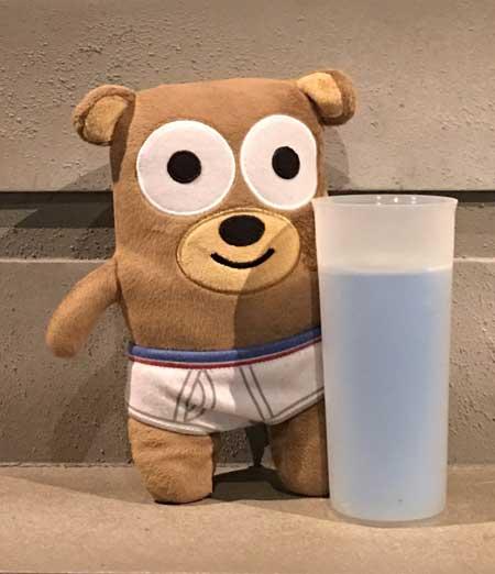 travel mascot roadie with blue milk