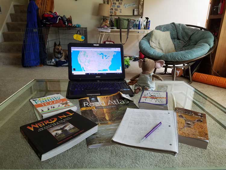 road trip planning tools with messy living room in the background
