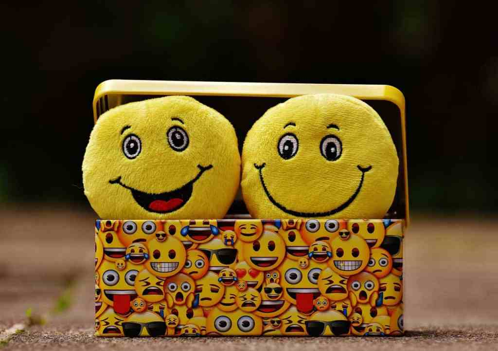 emoji box with smiley face pillows inside
