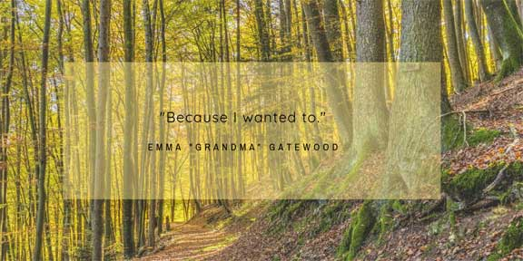 """""""Because I wanted to."""" Emma """"Grandma"""" Gatewood - quote text overlaid on forest path surrounded by tall trees"""