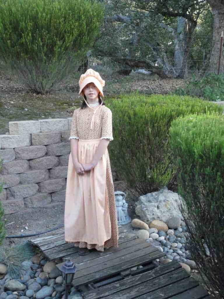 girl wearing pioneer dress costume