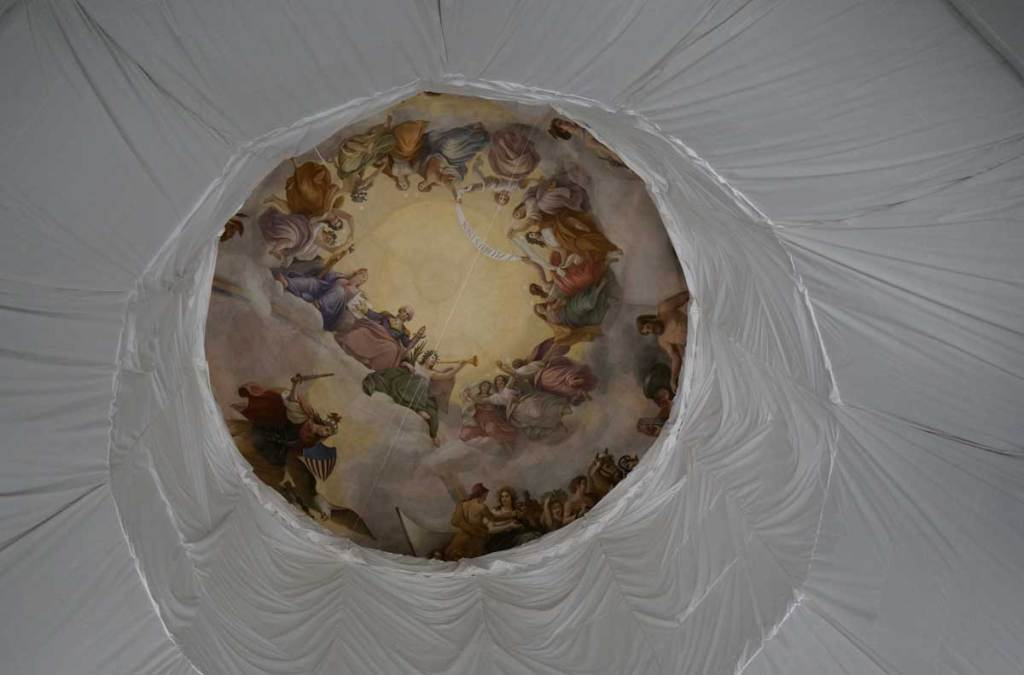 Painted ceiling of the dome, looking up in the Rotunda room at the US Capitol building.